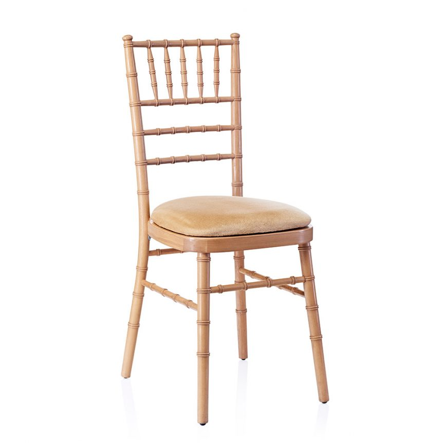 a natural chiavari chair with an ivory seat pad