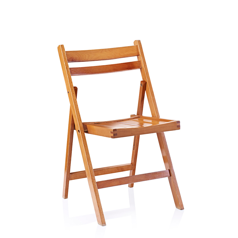 Coppper coloured wooden folding chairs which can be hired for rustic weddings