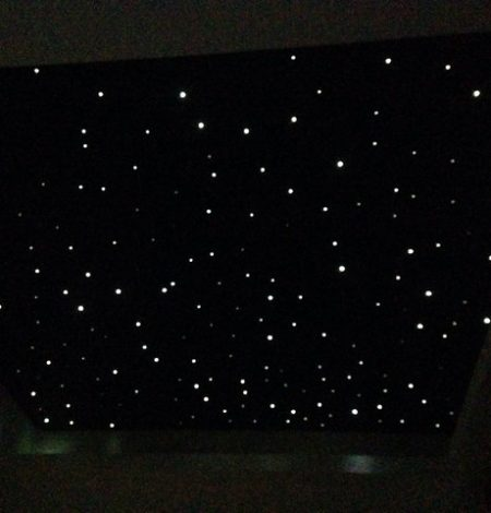 A starlight ceiling inside a marquee. Made by weaving lots of led lights into a black lining